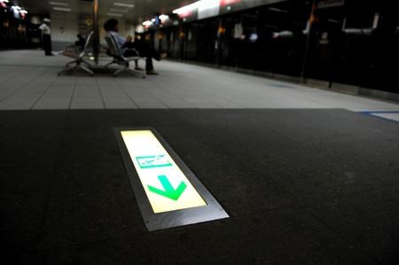 Emergency exit sign in subway station.
