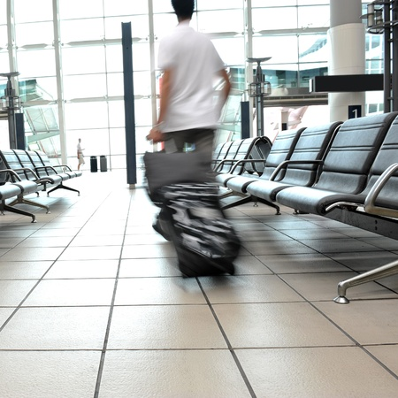 rushed: rushed passengers in the airport waiting room. Stock Photo