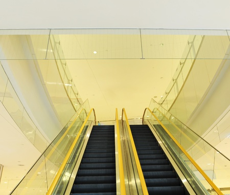 Move escalator in modern shopping mall  photo