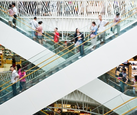 retail scenes: People in motion in escalators at the modern shopping mall.