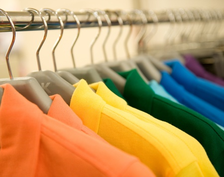 clothing store: fashion clothing on hangers at the show