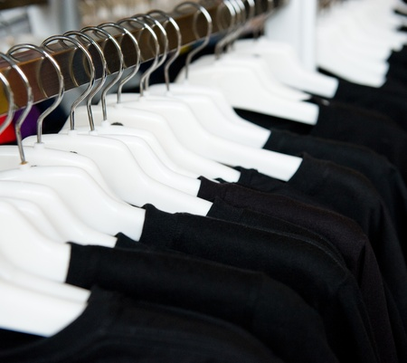 garb: fashion clothing on hangers at the show