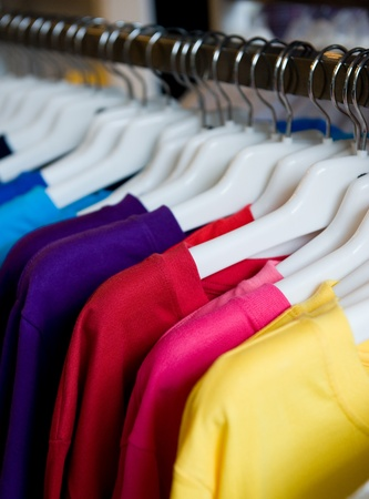retail display: fashion clothing on hangers at the show