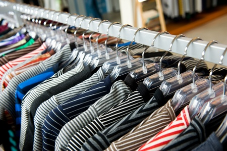color range: fashion clothing on hangers at the show