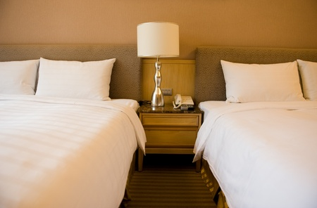 nightstand: Luxury hotel rooms with two beds.  Stock Photo