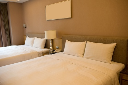 double bed: Luxury hotel rooms with two beds.  Stock Photo