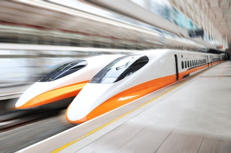 bullet train: two modern train speeding with motion blur.  Editorial