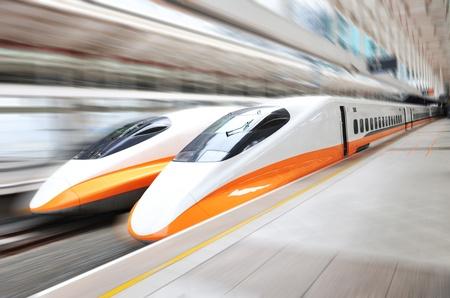 bullet train: two modern train speeding with motion blur.  Editorial