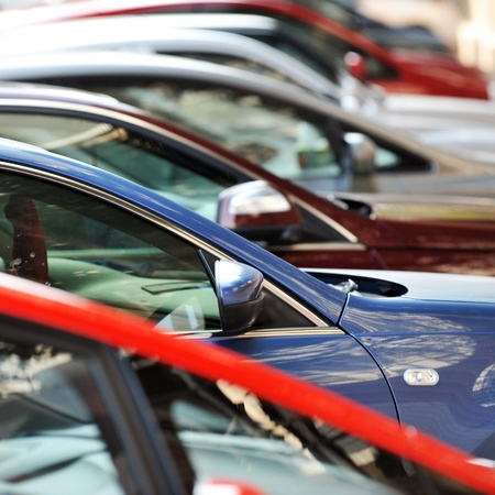 automobile dealers: many cars parked in a row  Stock Photo