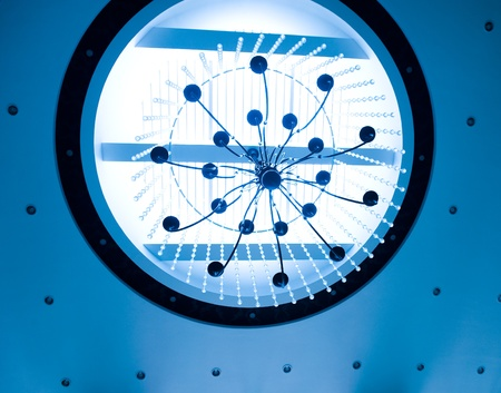 blue toned shot of round ceiling with beautiful crystal chandelier. photo