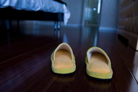 cloth halls: Slippers on the floor of hotel room.