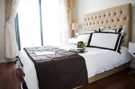 suite: Double bed in the modern interior room