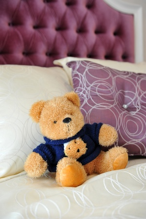 Close up of teddy bear in bed Stock Photo - 13536860