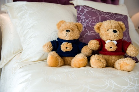 doll house: Close up of teddy bear in bed Stock Photo