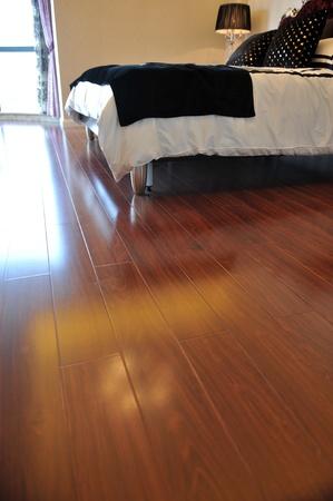 Luxury master bedroom with rich hardwoods. Stock Photo - 13536774