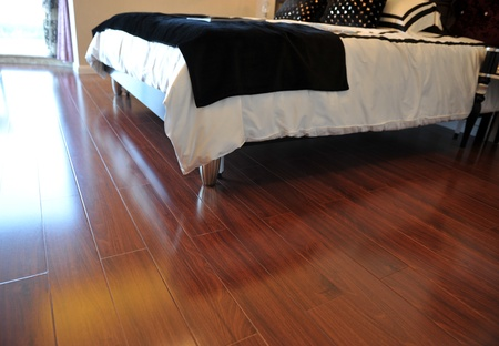 hardwoods: Luxury master bedroom with rich hardwoods.