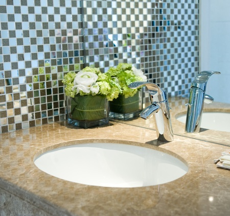bowl sink: Bathroom interior with sink and faucet