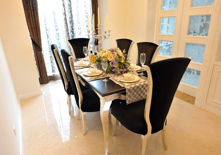 french doors: Dining room in luxury home with french doors  Stock Photo