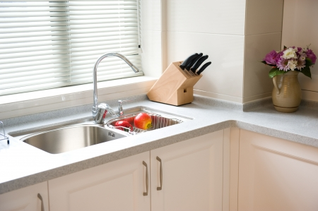 a blind: interior design of clean modern kitchen. Stock Photo
