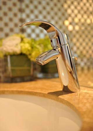 Bathroom interior with sink and faucet  photo