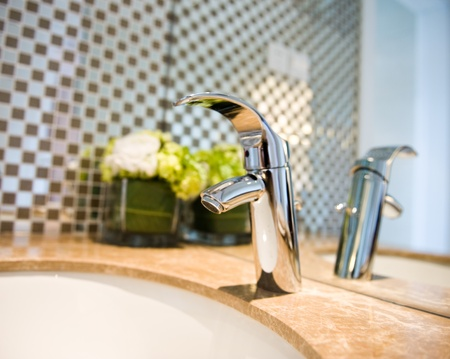 tap room: Bathroom interior with sink and faucet