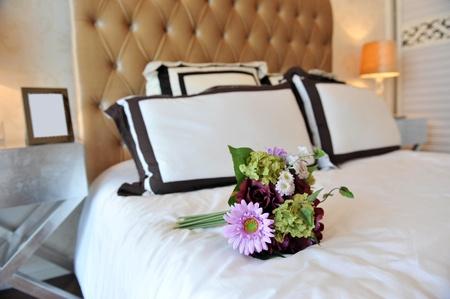Luxury bedding with beautiful flower.   photo