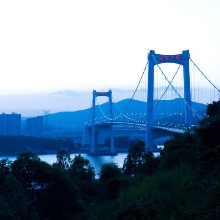bridge over sea at night in xiamen, China.  photo