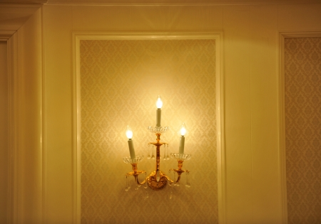 sconce: Sconce on a wall shining.