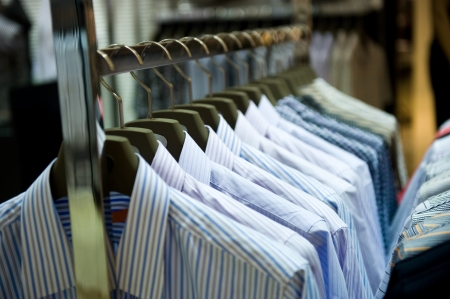 striped shirt: row of cloth hangers with shirts