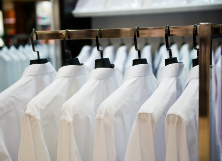 laundry: row of cloth hangers with shirts