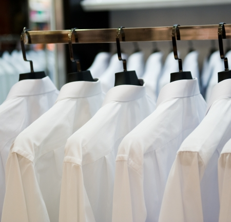 row of cloth hangers with shirts  photo