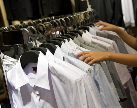 row of cloth hangers with shirts Stock Photo - 13613879