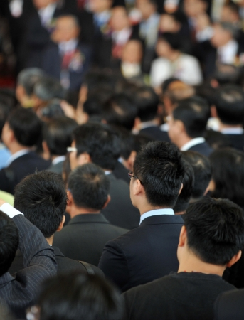 corporate culture: Rear view of businessmen in a crowd Editorial