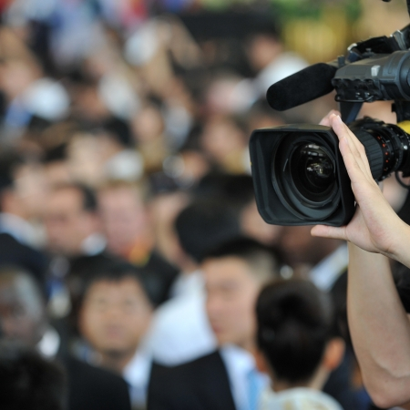 cameraman: Live broadcasting, television operator with camera. Selective focus on hand