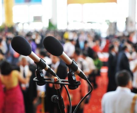 auditorium: Closeup microphone in auditorium with people. Editorial