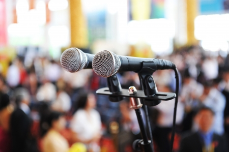 people in church: Closeup microphone in auditorium with people. Editorial