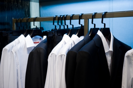 Row of men's suits hanging in closet. Stock Photo - 13648062