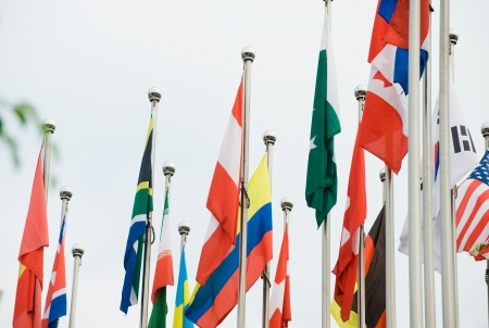 Flags of the world happily blowing in the wind. Stock Photo - 13647936