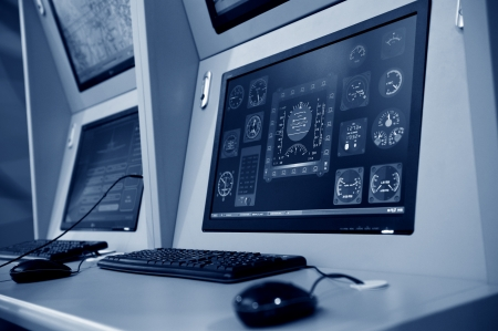 security monitor: flight controller working in the flight control tower. Stock Photo