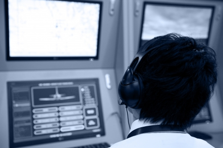 flight controller working in the flight control tower. photo
