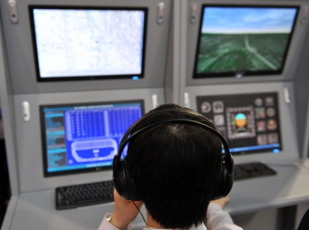 controller: flight controller working in the flight control tower. Stock Photo
