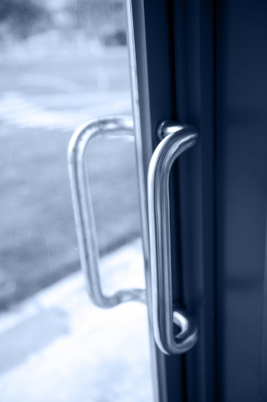 The door handle of modern office building.   photo