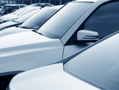 many cars parked in a row photo