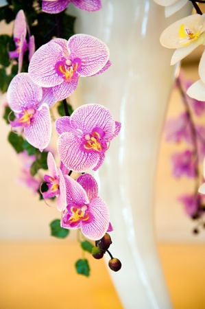 detail of purple artificial orchid.  photo