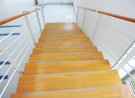 modern interior - wood stairs and handrail.  photo