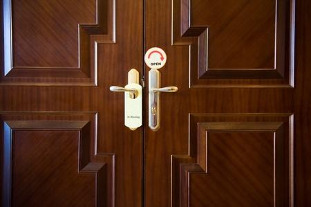 Meeting sign hanging from hotel door handle. photo