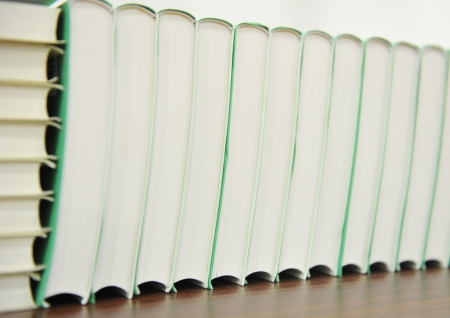stack of hardcover books in a line. photo