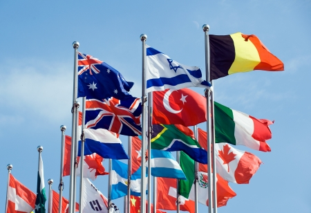 diplomacy: Flags of the world happily blowing in the wind.