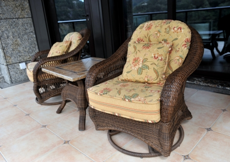 balcony with two chairs and table. photo