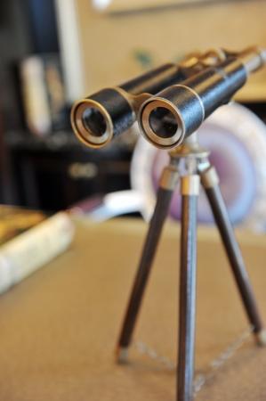 artifact: Vintage binoculars on the desk.